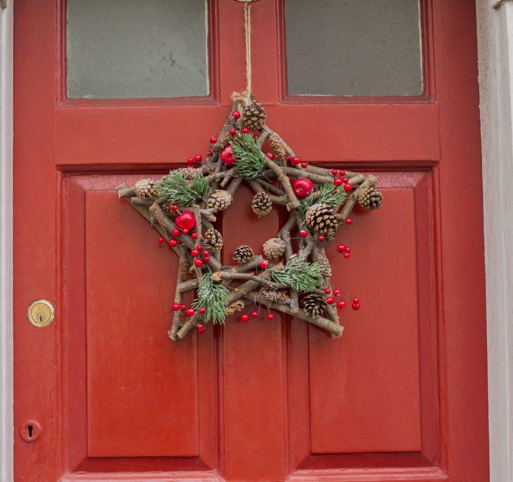 Star wreath on red door in Southwold