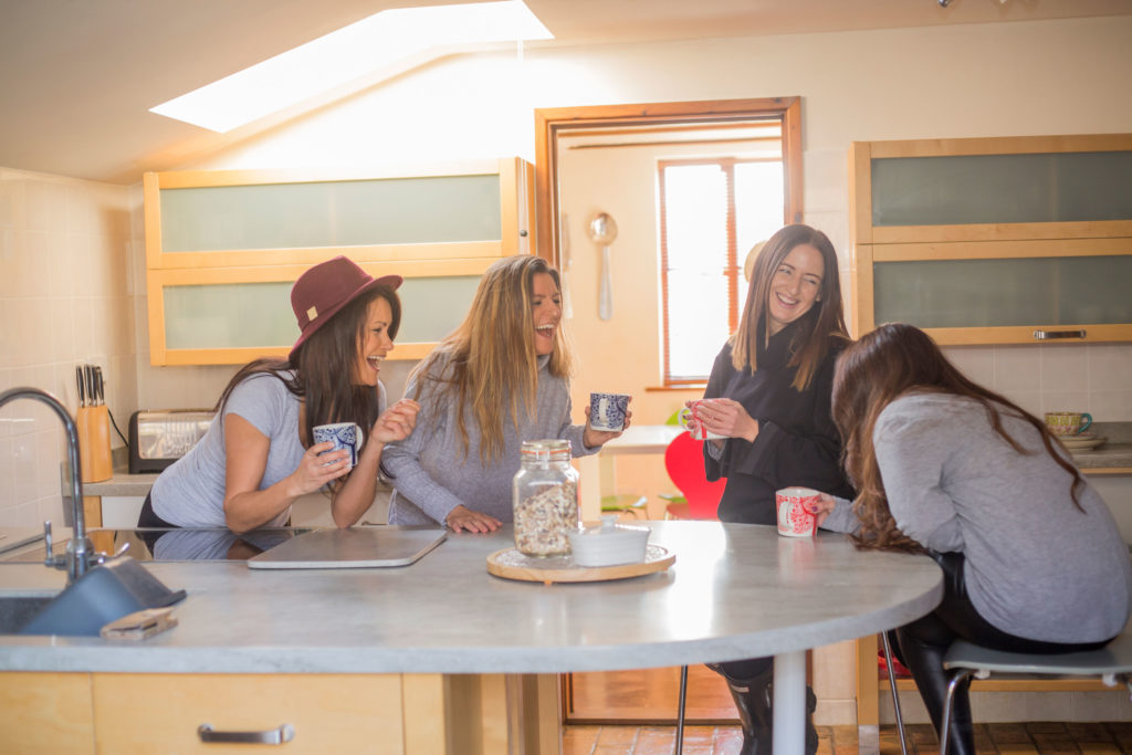 Group of girls gathered around kitchen table