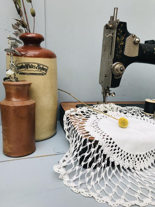 Crochet doily on vintage sewing machine from Stone & Sage