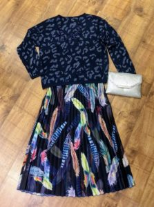 Jumper £35 Skirt £34 Necklace £16 Clutch bag £19