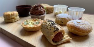 Suffolk afternoon tea by Country Cuisine on a wooden board