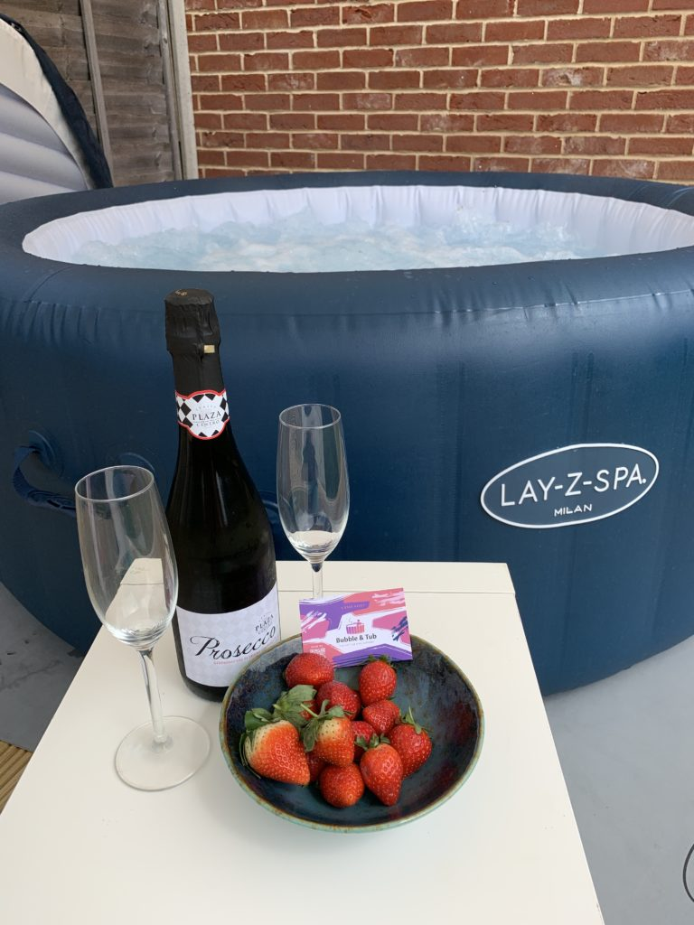hot tub hire in suffolk - hot tub with Prosecco and strawberries and two glasses