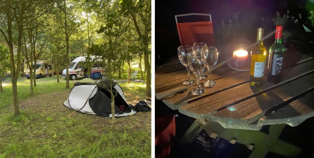sunset and stars campsite - tent with camper vans behind and a table with glasses and bottle of wine